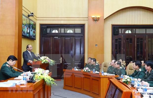Asiste premier vietnamita a conferencia sobre defensa de zonas militares hinh anh 1