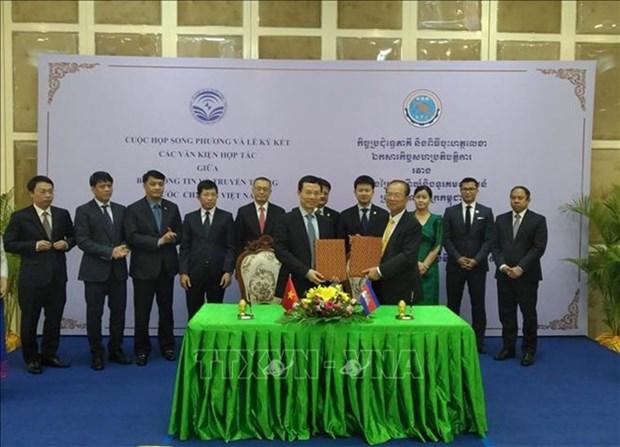 Firman Vietnam y Camboya acuerdos de cooperacion telecomunicaciones e informatica hinh anh 1
