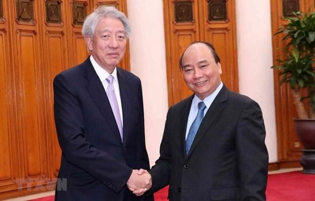 Premier vietnamita exhorta a mayores esfuerzos para impulsar nexos con Singapur hinh anh 1