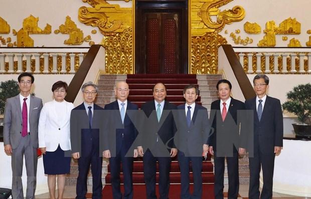 Recibe premier vietnamita al presidente de la Comision sudcoreana de Comunicaciones hinh anh 1
