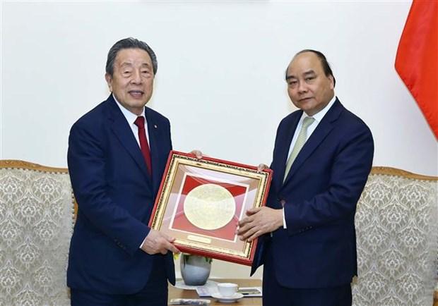 Comprometido premier de Vietnam a crear entorno favorable para inversores extranjeros hinh anh 1