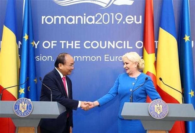 Premieres de Vietnam y Rumania copresidieron la conferencia de prensa en Bucarest hinh anh 1