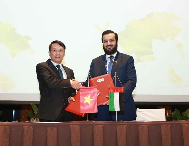 Firman acuerdo de colaboracion las agencias de noticias de Vietnam y de Emiratos Arabes Unidos hinh anh 1