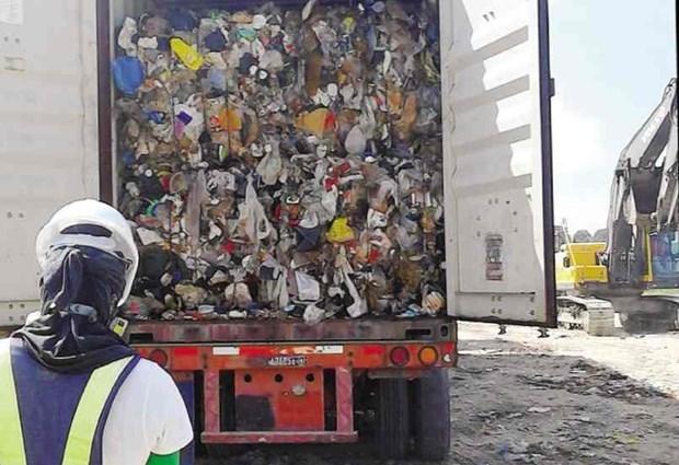 Acepta Canada devolucion de contenedores de basuras enviados a Filipinas hinh anh 1
