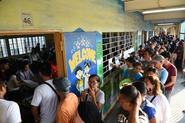 Triunfa partido gobernante en elecciones parciales en Filipinas, segun resultado preliminar hinh anh 1