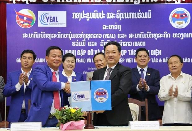 Incrementaran la cooperacion empresas de Vietnam y Laos hinh anh 1