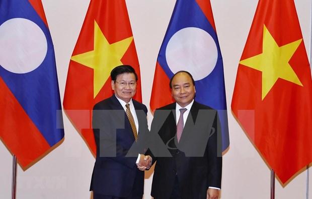 Premier vietnamita recibe a su homologo laosiano hinh anh 1