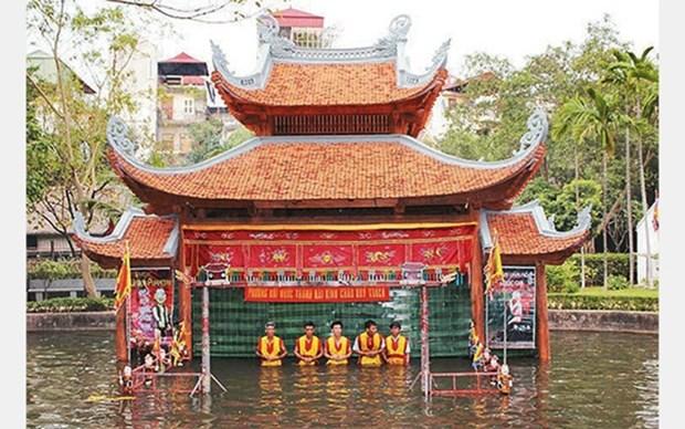 Artesanos vietnamitas preservan la arquitectura tradicional en la vida contemporanea hinh anh 1