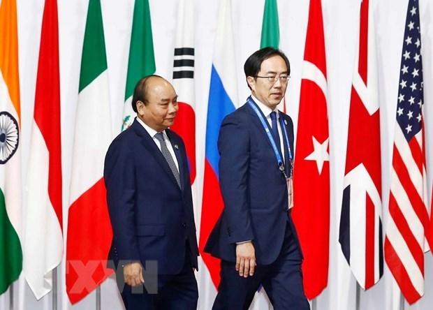 Primer ministro vietnamita se reune con ejecutivos de grandes empresas tecnologicas japonesas hinh anh 1