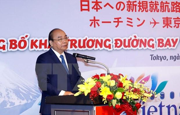 Participa primer ministro de Vietnam en inauguracion de nuevos vuelos entre su pais y Japon hinh anh 1