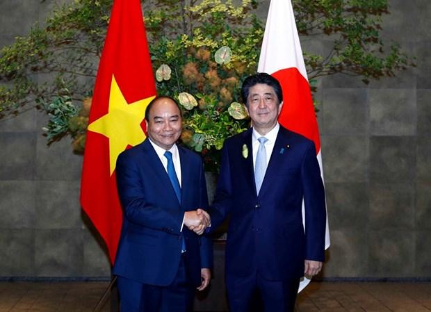Regresa premier de Vietnam a su pais tras participar en Cumbre G20 en Japon hinh anh 1