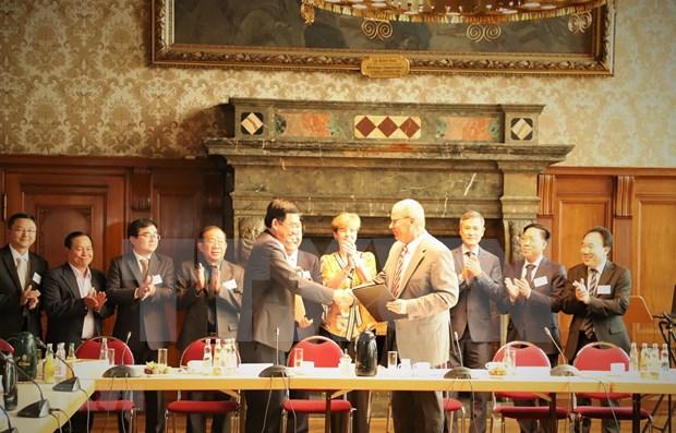Acuerdan localidades de Vietnam y Alemania incrementar cooperacion hinh anh 1