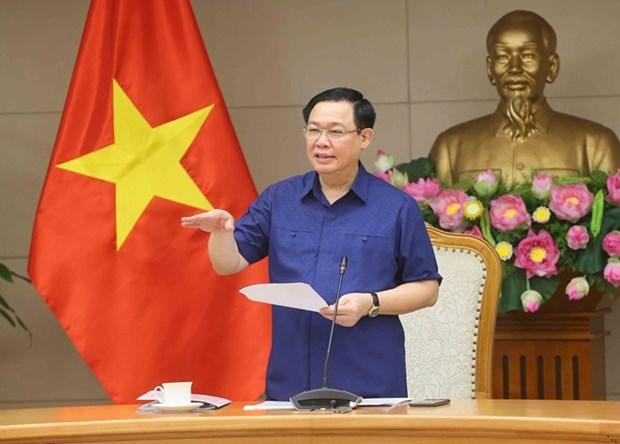 Vicepremier vietnamita pide mayores esfuerzos por estabilizar la macroeconomia hinh anh 1