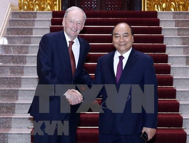 Recibe primer ministro de Vietnam a expremier canadiense Jean Chretien hinh anh 1
