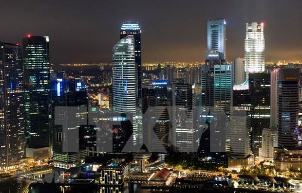 Economia de Singapur registra crecimiento mas lento en una decada hinh anh 1