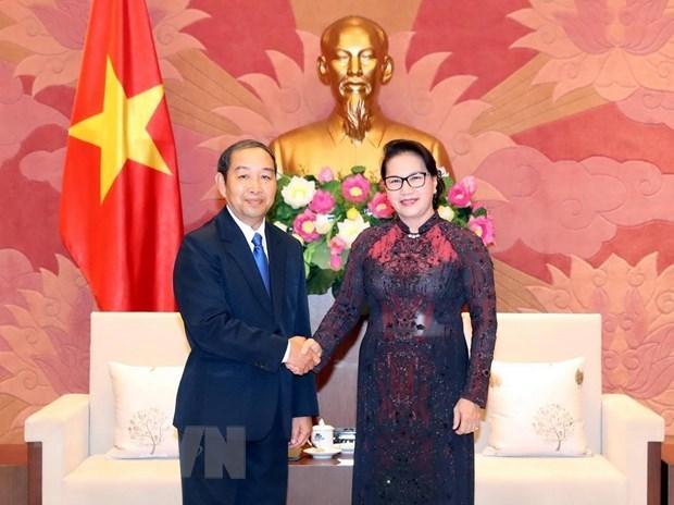 Presidenta parlamentaria vietnamita recibe al titular del Tribunal Popular Supremo de Laos hinh anh 1