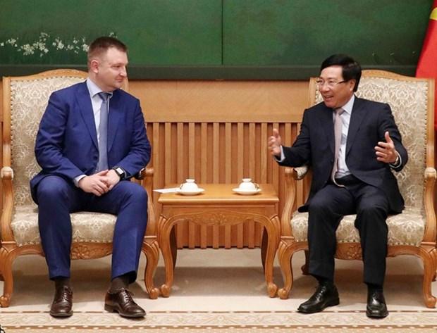 Vicepremier y canciller vietnamita recibe a delegacion rusa hinh anh 1