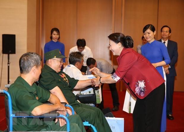 Maxima legisladora de Vietnam reitera atencion especial a personas con meritos revolucionarios hinh anh 1