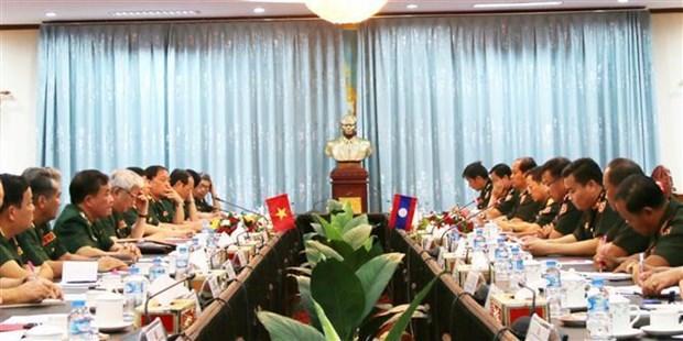 Vietnam y Laos sostienen primer intercambio de politicas de defensa hinh anh 1