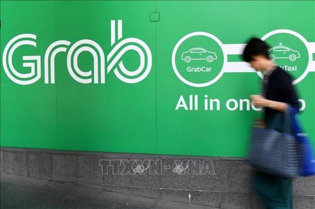 Invertira Grab dos mil millones de dolares en Indonesia con fondos de SoftBank hinh anh 1