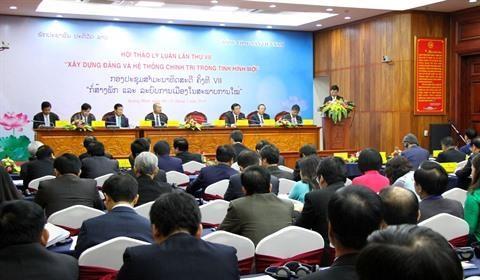 Inauguran VII seminario teorico entre partidos de Vietnam y Laos hinh anh 1