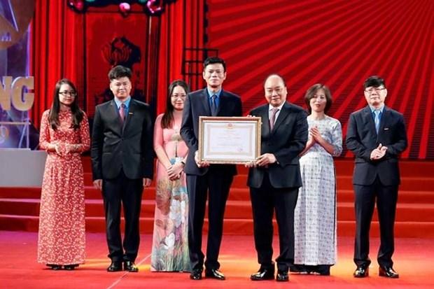Asiste premier de Vietnam a ceremonia del 90 aniversario del periodico Lao Dong hinh anh 1