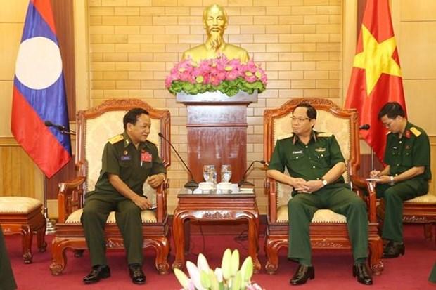 Ejercitos de Vietnam y Laos fortalecen colaboracion en proteccion politica interna hinh anh 1