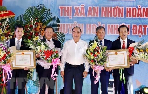Premier vietnamita en ceremonia de reconocimiento de zonas rurales de nuevo estilo en Binh Dinh hinh anh 1