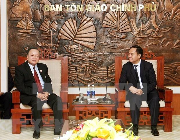 Comparten Vietnam y Laos experiencias en gestion de asuntos religiosos hinh anh 1