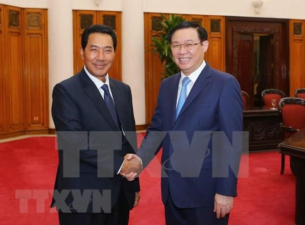 Recibe viceprimer ministro vietnamita al vicepresidente de la Asamblea Nacional de Laos hinh anh 1
