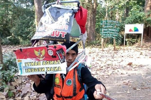 Camina indonesio 700 kilometros hacia atras para oponerse a la deforestacion hinh anh 1