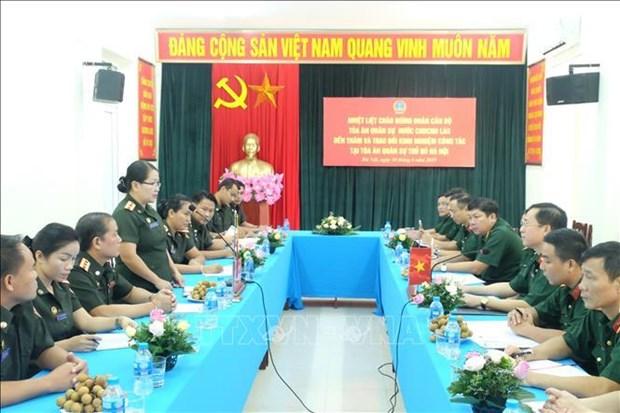 Intercambian experiencias tribunales militares de Vietnam y Laos hinh anh 1