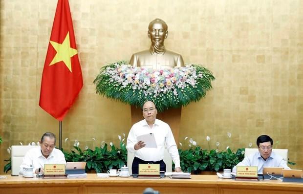 Primer ministro de Vietnam insta a reforma institucional para impulsar el crecimiento economico hinh anh 1