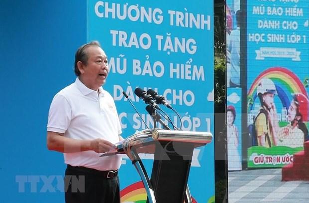 Impulsa Vietnam uso de cascos para ninos por seguridad vial hinh anh 1