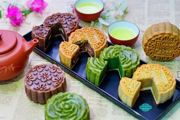 Preservan en Vietnam oficio tradicional de elaboracion de molde de pastel de luna hinh anh 1