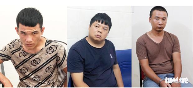 Capturan en Vietnam a tres chinos por falsificar tarjetas de cajeros automaticos hinh anh 1