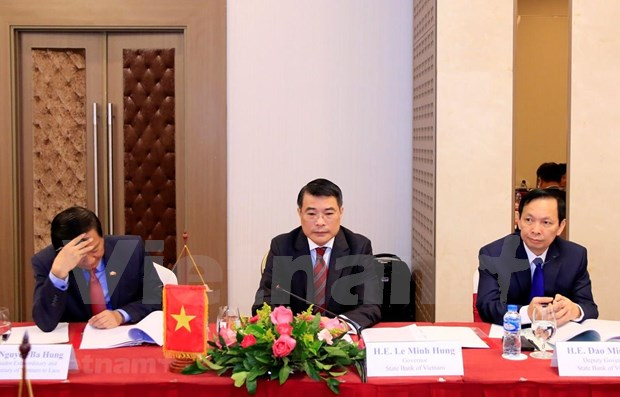Robustecen bancos estatales de Vietnam y Laos su cooperacion hinh anh 1