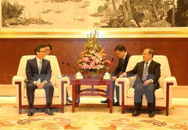 Participa vicepremier vietnamita en Exposicion y Cumbre de Negocios e Inversion ASEAN- China hinh anh 1
