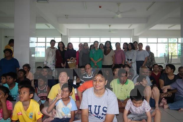 Ofrece Circulo de Mujeres de la ASEAN asistencia a huerfanos en Malasia hinh anh 1
