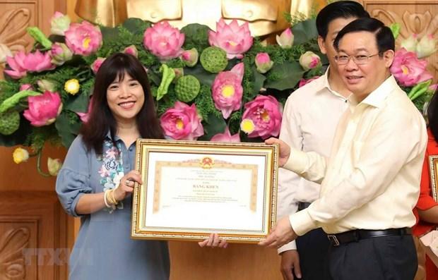 Recibe unidad informativa de la VNA diploma de merito por sus aportes al control de precios hinh anh 1