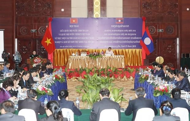 Debaten los Parlamentos de Vietnam y Laos asuntos referentes al bienestar social hinh anh 1