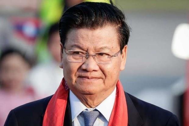 Iniciara primer ministro de Laos visita oficial a Vietnam hinh anh 1