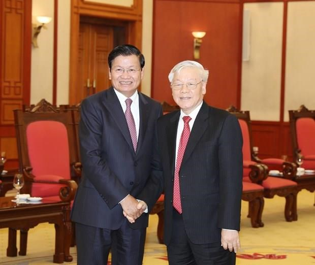 Recibe maximo dirigente de Vietnam al Premier de Laos hinh anh 1
