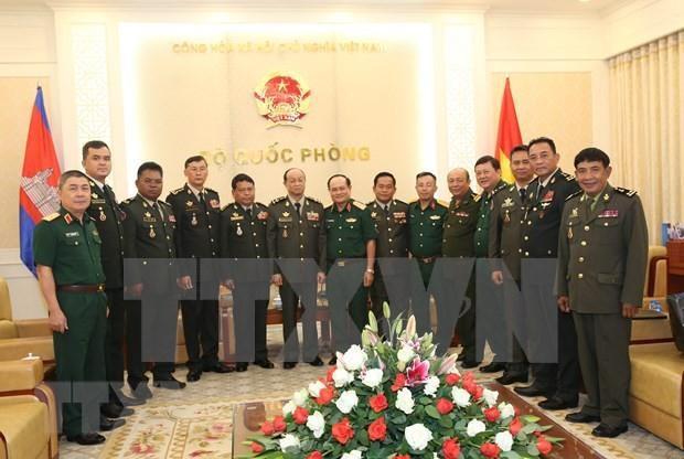 Intercambian experiencias Vietnam y Camboya sobre mantenimiento de la paz hinh anh 1