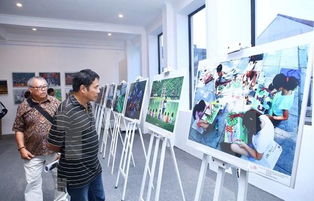 Honran fotografos nacionales y extranjeros la belleza de Hanoi hinh anh 1