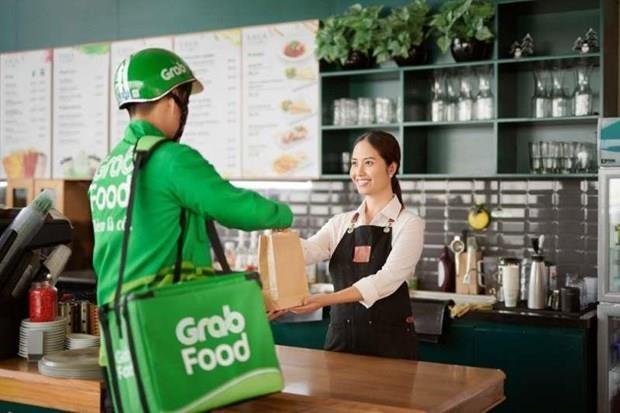 Debuta el servicio GrabKitchen en Ciudad Ho Chi Minh hinh anh 1