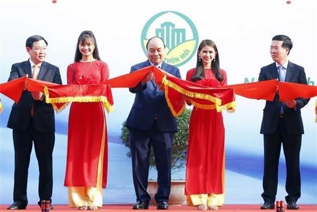 Asiste Premier a inauguracion de exposicion sobre areas rurales de nuevo estilo hinh anh 1