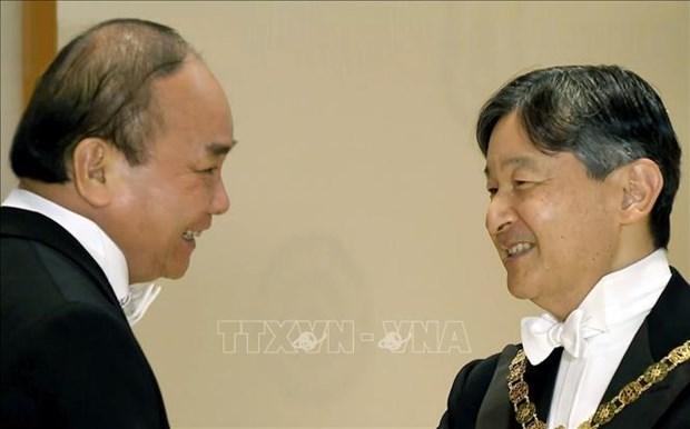Concluye Premier de Vietnam viaje a Japon para coronacion imperial hinh anh 1