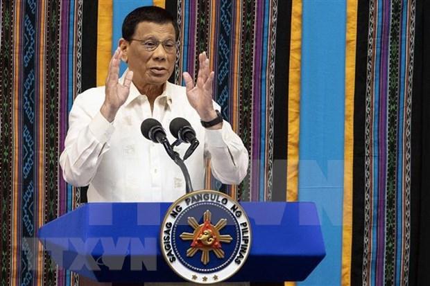 Acorta presidente filipino visita a Japon por razones de salud hinh anh 1