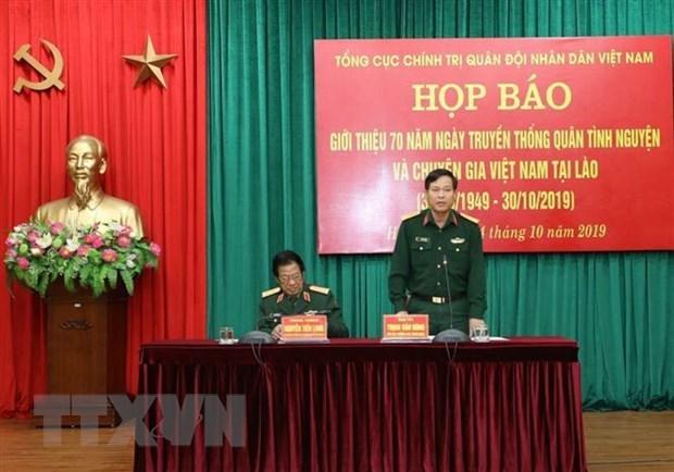 Conmemoran 70 anos de soldados voluntarios vietnamitas y expertos en Laos hinh anh 1